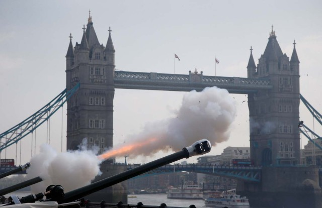 Members of the Honourable Artillery Company fire a 62-gun salute across the River Thames to mark the 92nd birthday of Britain's Queen Elizabeth, at the Tower of London, Britain April 21, 2018. REUTERS/Henry Nicholls