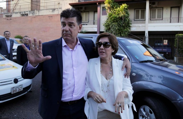 Paraguayan presidential candidate Efrain Alegre and his wife Mirian Irun arrive for a meeting with the media in Asuncion, during national election day, Paraguay April 22, 2018. REUTERS/Jorge Adorno