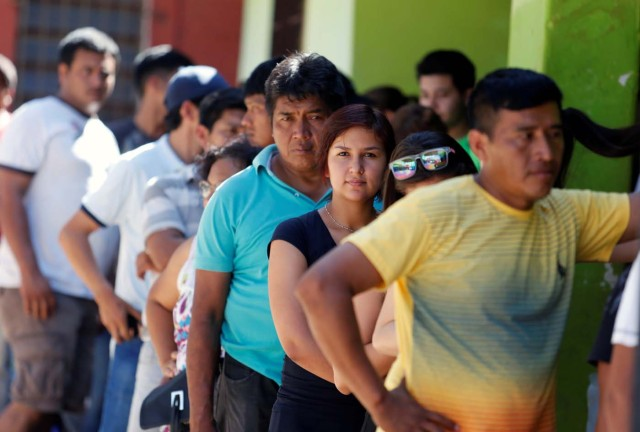 People line up to cast their vote during Paraguay's national elections, on the outskirts of Asuncion, Paraguay April 22, 2018. REUTERS/Andres Stapff