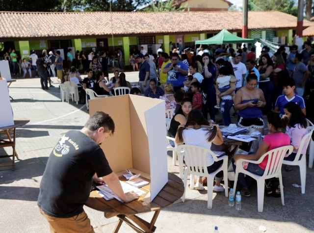 A man choses his vote during Paraguay's national elections in the outskirts of Asuncion, Paraguay April 22, 2018. REUTERS/Mario Valdez
