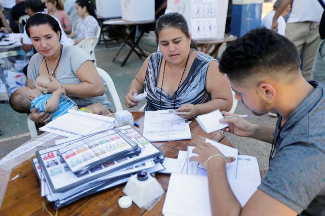 Electoral workers check materials during Paraguay's national elections on the outskirts of Asuncion, Paraguay April 22, 2018. REUTERS/Mario Valdez