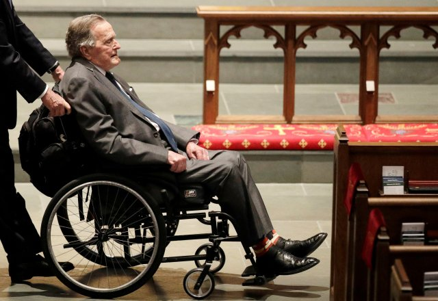 FILE PHOTO: Former President George H.W. Bush, arrives at St. Martin's Episcopal Church for funeral services for former first lady Barbara Bush in Houston, Texas, U.S., April 21, 2018. David J. Phillip/Pool via Reuters/File Photo