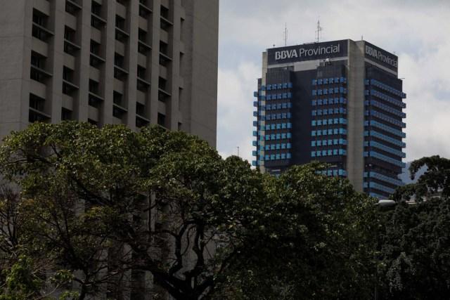 The logo of BBVA Provincial is seen atop a building in Caracas, Venezuela April 6, 2018. Picture taken April 6, 2018. REUTERS/Marco Bello