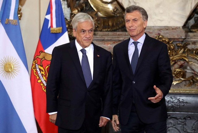 Argentine President Mauricio Macri (R) and his Chilean counterpart, Sebastian Pinera, pose for a photo at the Casa Rosada Presidential Palace in Buenos Aires, Argentina April 26, 2018. REUTERS/Marcos Brindicci