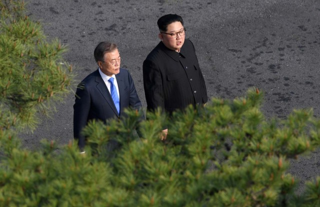 South Korean President Moon Jae-in and North Korean leader Kim Jong Un walk together at the truce village of Panmunjom inside the demilitarized zone separating the two Koreas, South Korea, April 27, 2018. Korea Summit Press Pool/Pool via Reuters
