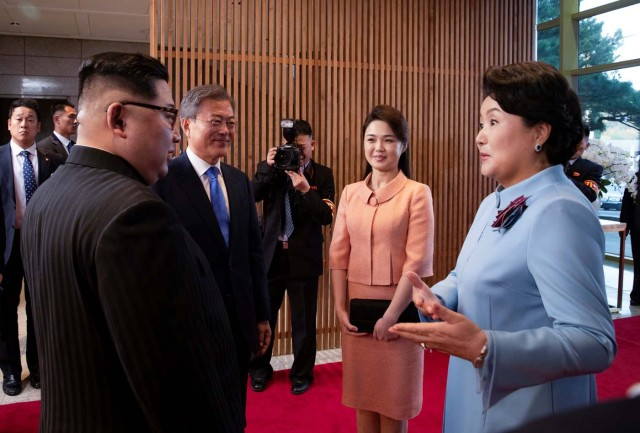 South Korean President Moon Jae-in and North Korean leader Kim Jong Un meet Kim's wife Ri Sol Ju and Moon's wife Kim Jung-sook at the truce village of Panmunjom inside the demilitarized zone separating the two Koreas, South Korea, April 27, 2018. Korea Summit Press Pool/Pool via Reuters