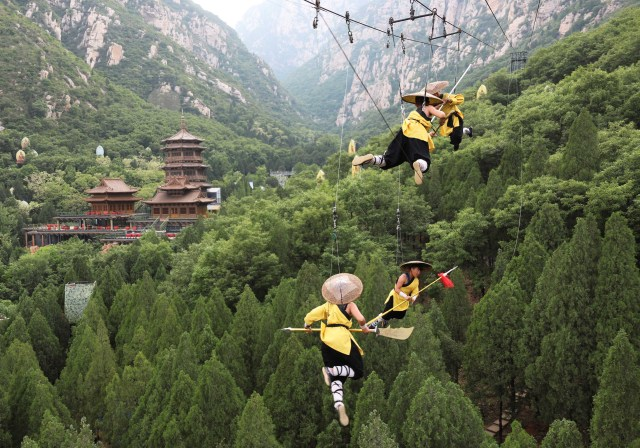 Shaolin martial arts students perform Kung Fu suspended on wires in a rehearsal for a live-action night show in Zhengzhou, Henan province, China April 28, 2018. Picture taken April 28, 2018. REUTERS/Stringer ATTENTION EDITORS - THIS IMAGE WAS PROVIDED BY A THIRD PARTY. CHINA OUT. NO COMMERCIAL OR EDITORIAL SALES IN CHINA.