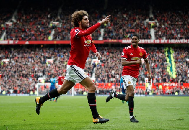 "Soccer Football - Premier League - Manchester United v Arsenal - Old Trafford, Manchester, Britain - April 29, 2018   Manchester United's Marouane Fellaini celebrates scoring their second goal with Marcus Rashford   Action Images via Reuters/Carl Recine    EDITORIAL USE ONLY. No use with unauthorized audio, video, data, fixture lists, club/league logos or ""live"" services. Online in-match use limited to 75 images, no video emulation. No use in betting, games or single club/league/player publications.  Please contact your account representative for further details."