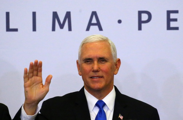 U.S. Vice President Mike Pence poses at the family photo of the VIII Summit of the Americas in Lima, Peru April 14, 2018. REUTERS/Ivan Alvarado