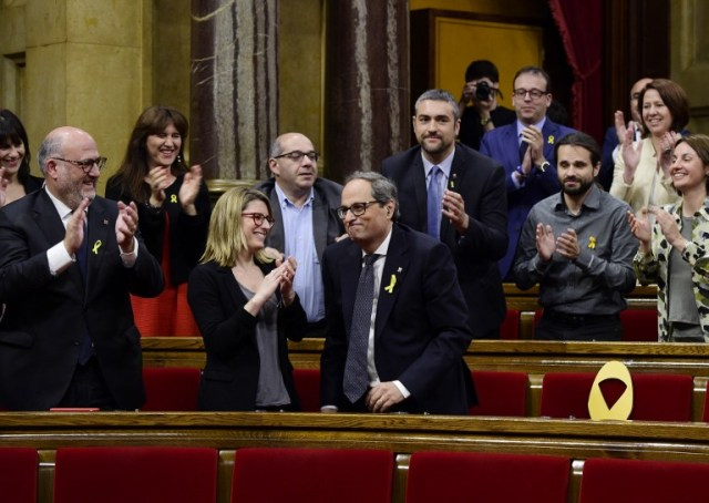 / AFP PHOTO / LLUIS GENE