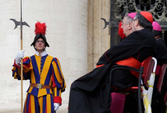 A Swiss guard stands during Pope Francis' Wednesday general audience in Saint Peter's square at the Vatican, April 18, 2018. REUTERS/Max Rossi