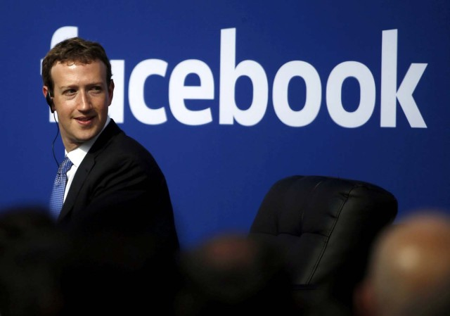 FILE PHOTO: Facebook CEO Mark Zuckerberg is seen on stage during a town hall at Facebook's headquarters in Menlo Park, California September 27, 2015. REUTERS/Stephen Lam/File Photo