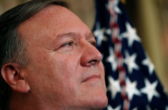 U.S. Secretary of State Mike Pompeo listens to remarks made by President Donald Trump during Pompeo's swearing-in ceremony at the Department of State in Washington, U.S., May 2, 2018. REUTERS/Leah Millis