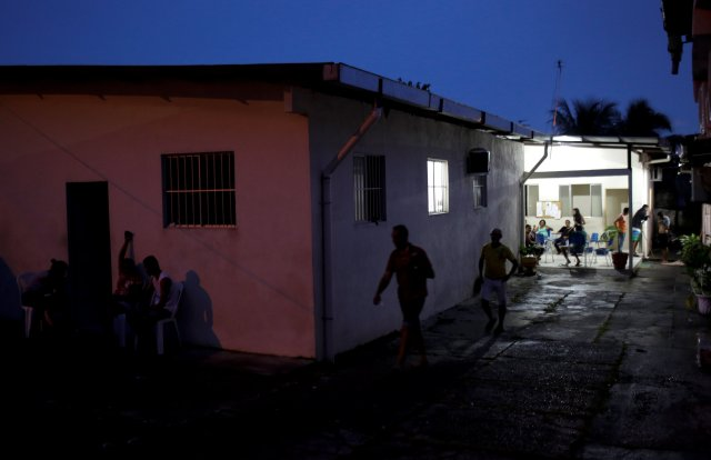 Venezuelan refugees go about their activities at the Joao Batista Scalabrini shelter of the archdiocese of Manaus in the Santo Antonio neighbourhood in Manaus, Brazil May 1, 2018. Picture taken May 1, 2018. REUTERS/Bruno Kelly