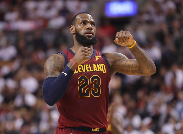 May 3, 2018; Toronto, Ontario, CAN; Cleveland Cavaliers forward LeBron James (23) celebrates after making a basket against the Toronto Raptors in game two of the second round of the 2018 NBA Playoffs at Air Canada Centre. The Cavaliers beat the Raptors 128-110. Mandatory Credit: Tom Szczerbowski-USA TODAY Sports