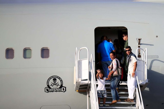 Venezuelan refugees are seen during boarding a Brazilian Air Force plane, heading to Manaus and Sao Paulo, at Boa Vista Airport, Brazil May 4, 2018. REUTERS/Ueslei Marcelino