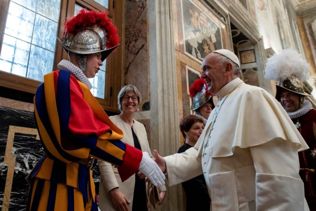 Pope Francis shakes hands with a Swiss guard the day ahead of their swearing-in ceremony at the Vatican, May 4, 2018. Osservatore Romano/Handout via REUTERS ATTENTION EDITORS - THIS IMAGE WAS PROVIDED BY A THIRD PARTY