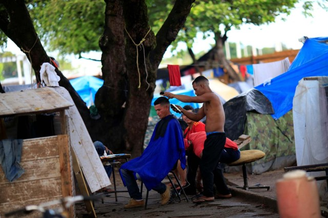 Venezuelan migrants are seen in a makeshift camp at Simon Bolivar square in Boa Vista, Brazil May 3, 2018. Picture taken May 3, 2018. REUTERS/Ueslei Marcelino