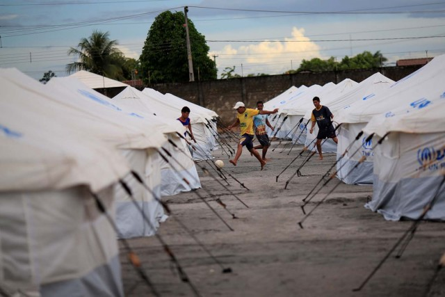 Venezuelan migrants play soccer between the tents in a UNHCR shelter in Boa Vista, Brazil May 3, 2018. Picture taken May 3, 2018. REUTERS/Ueslei Marcelino