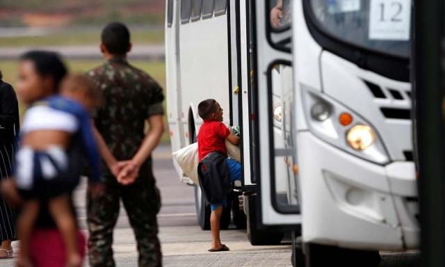 A Venezuelan refugee boy arrives at the Eduardo Gomes International airport in Manaus, Brazil May 4, 2018. REUTERS/Bruno Kelly