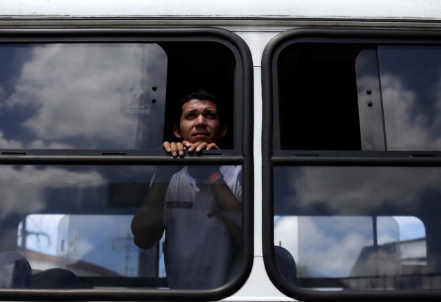 A Venezuelan refugee watches from a bus window as he arrives at UNHCR shelter in Manaus, Brazil May 4, 2018. REUTERS/Bruno Kelly