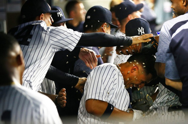 May 4, 2018; Bronx, NY, USA; New York Yankees second baseman Gleyber Torres (25) is showered with peanuts after hitting a three run home run against the Cleveland Indians during the fourth inning at Yankee Stadium. Mandatory Credit: Andy Marlin-USA TODAY Sports