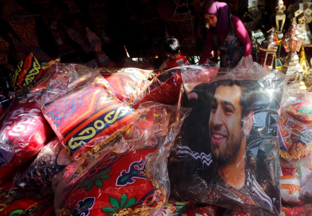 A pillow bearing the image of Liverpool's Egyptian forward soccer player Mohamed Salah is seen at a market, before the beginning of the holy fasting month of Ramadan in Cairo, Egypt May 16, 2018. REUTERS/Amr Abdallah Dalsh