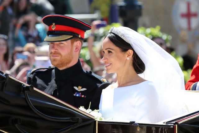 Meghan Markle and Prince Harry leave St George's Chapel at Windsor Castle after their wedding  Saturday May 19, 2018.  Gareth Fuller/Pool via REUTERS