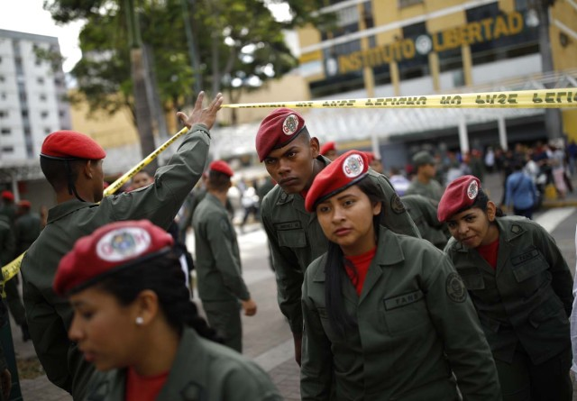 Venezuelan soldiers arrive at a polling station during the presidential election in Caracas, Venezuela, May 20, 2018. REUTERS/Carlos Garcia Rawlins