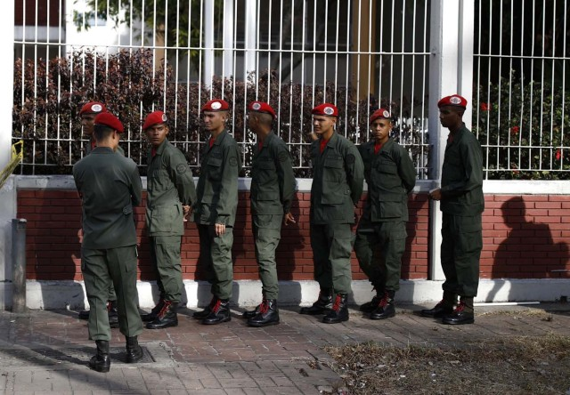 Venezuelan soldiers wait in line to vote at a polling station during the presidential election in Caracas, Venezuela, May 20, 2018. REUTERS/Carlos Garcia Rawlins