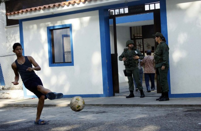 A youth kicks a ball in front of a polling station during the presidential election in San Cristobal, Venezuela, May 20, 2018. REUTERS/Carlos Eduardo Ramirez