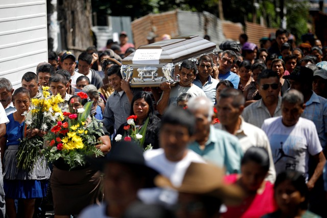 REFILE - CORRECTING LOCATION  People carry the coffin of 17-year-old Aura Yolanda Perez Paz, who died during the eruption of the Fuego volcano, at her funeral in Alotenango, Guatemala  June 12, 2018. REUTERS/Jose Cabezas