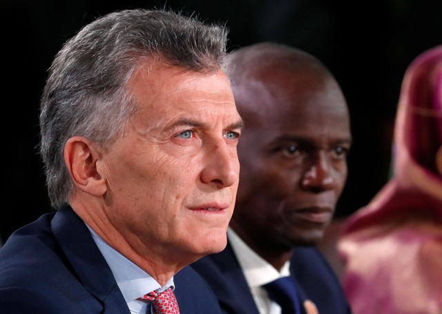 Argentina's President Mauricio Macri and Haiti's President Jovenel Moise (R) attend a G7 and outreach countries summit as part of a G7 summit in the Charlevoix city of La Malbaie, Quebec, Canada, June 9, 2018. REUTERS/Yves Herman