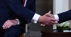 El lenguaje corporal de Trump y Putin (fotos)