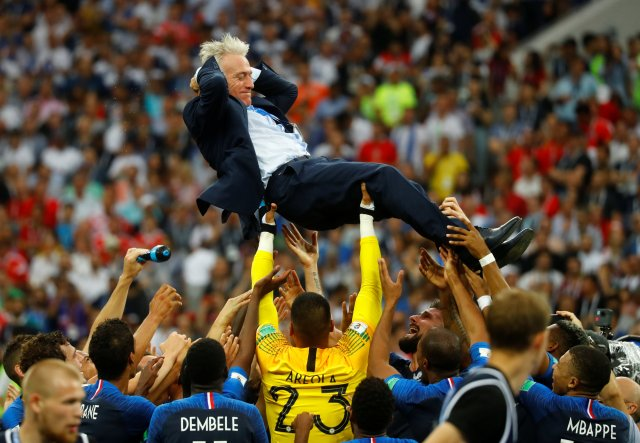 Soccer Football – World Cup – Final – France v Croatia – Luzhniki Stadium, Moscow, Russia – July 15, 2018 France coach Didier Deschamps is thrown into the air by his players as they celebrate after winning the World Cup REUTERS/Kai Pfaffenbach