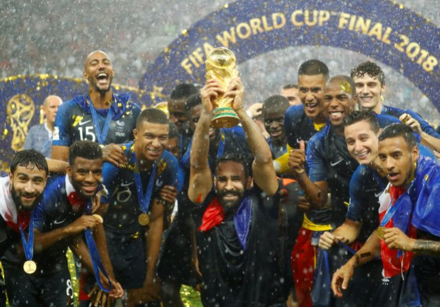 Soccer Football – World Cup – Final – France v Croatia – Luzhniki Stadium, Moscow, Russia – July 15, 2018 France's Adil Rami and team mates celebrate with the trophy after winning the World Cup REUTERS/Kai Pfaffenbach
