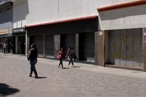 Venezolanos temen caos y paralización del comercio por eliminación de cinco ceros al bolívar (FOTOS)