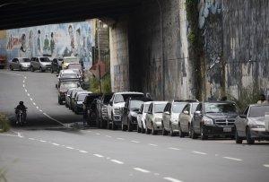 Venezuelan gas lines surge as Iranian tankers go undercover